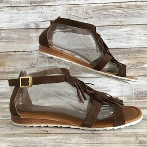 A Giannetti Brown Suede Fringe Gladiator Sandals.